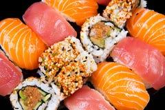 Sushi et roulis Photographie stock libre de droits