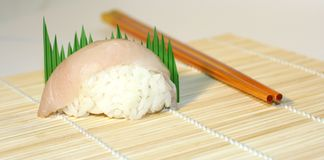 Sushi exhibition. Fresh Sushi over makisu macro with Chopsticks, part of a serie of 7 Royalty Free Stock Photography