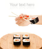 sushi för handholdingmaki Royaltyfria Foton