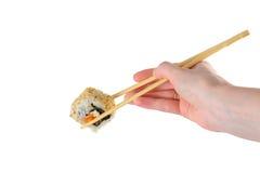 Sushi. Female hand holding chopsticks delicious Japanese sushi Royalty Free Stock Photography