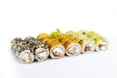 Sushi fijado en el fondo blanco Foto de archivo libre de regalías