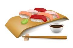 Sushi fijado en el tablero de madera Imagen de archivo
