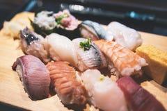 Sushi fijado en la comida de madera del japonés de la placa Imagen de archivo libre de regalías