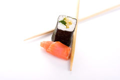 Sushi with fish and chopsticks on white Royalty Free Stock Images