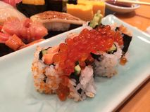 Sushi. With fish eggs Royalty Free Stock Photos