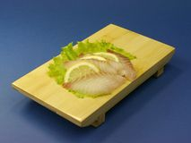 Sushi fish with lemon slices Stock Photo