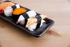 Sushi. Five sushi on white background Royalty Free Stock Photography