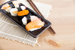 Sushi. Five sushi on wooden table Royalty Free Stock Images
