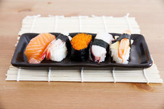 Sushi. Five sushi on wooden table Stock Photos