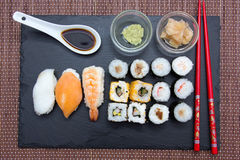 Sushi on flat slate on bamboo seen from above Stock Image