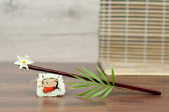 Sushi with flower and chopstick. Stock Image