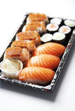 Sushi food on tray against white background Stock Images