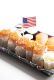 Sushi food on tray with American flag against white background Stock Photo