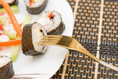 Sushi on a fork Stock Image