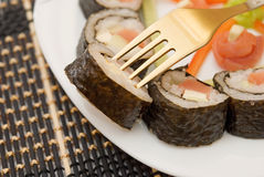 Sushi on a fork Stock Photo
