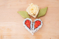 Sushi forming hearts and flower shapes Stock Photography