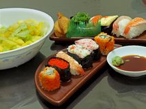 Sushi and Fruit Salad. Healthy Living ! A variety of sushi and fruit Salad Stock Photos