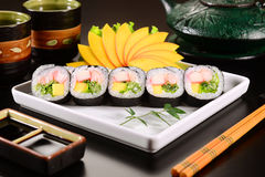 Sushi. Futomaki sushi on white squared dish royalty free stock images