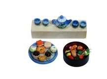Sushi, gâteaux de thé et thé Image stock