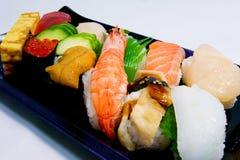 Sushi giapponesi di nigiri dei frutti di mare di lusso Fotografia Stock