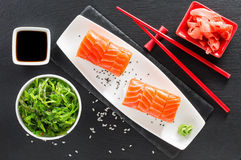 Sushi and green seaweed salad on a slate table Stock Images
