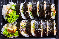 Sushi with grilled salmon. Set of futomaki sushi with grilled salmon Stock Photos