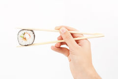 Sushi in a hand Royalty Free Stock Photography