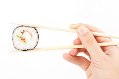 Sushi in a hand Stock Photos