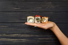 Sushi on the hand of a girl Royalty Free Stock Photo