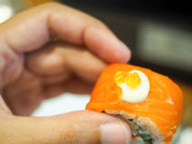 Sushi on hand. Sushi on left hand ready to eat Stock Photo
