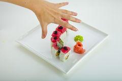 Sushi and hands Stock Photos