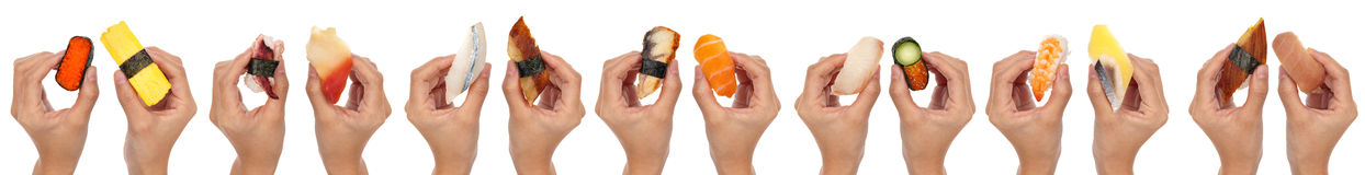 Sushi Hands. 14 hands holding various kinds of sushi/sashimi isolated on white Royalty Free Stock Images