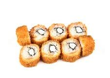 Sushi, heet broodje in beslag een witte achtergrond Japans voedsel stock afbeeldingen