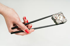 Sushi holds a hand on a stick Stock Photography