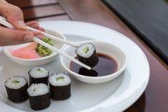 Sushi Hoso Maki. Hoso Maki Sushi Vegetarian with wasabi and ginger stock photo
