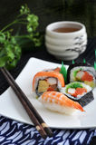 Sushi with hot tea Stock Images