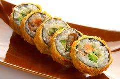 sushi i brun platta Royaltyfri Bild