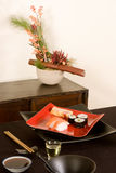 Sushi and ikebana flowers Stock Photos