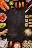 Sushi and ingredients on dark background Royalty Free Stock Image