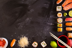 Sushi and ingredients on dark background Stock Photo
