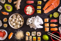 Sushi and ingredients on dark background Stock Photo