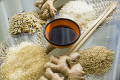 Sushi ingredients. Different types of asian rice, chopsticks, straw matt for rolls, soy sauce Stock Photography