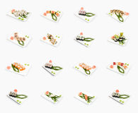 Sushi isolated. Sushi menu, small isolated pieces of raw food, placed at plates Royalty Free Stock Images