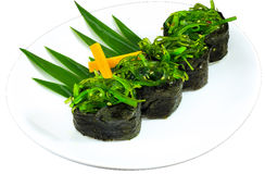 Sushi. The Isolation japanese traditonal food in the decorated container royalty free stock photography