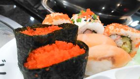 Food of Japan in the Thai restaurant. Sushi of Japan food in the restaurant of Thailand in holiday royalty free stock photos
