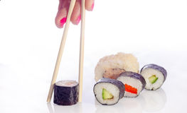 Sushi Japanese dishes. Sushi is a Japanese food consisting of cooked vinegared rice combined with other ingredients, seafood, vegetables and sometimes tropical Royalty Free Stock Image