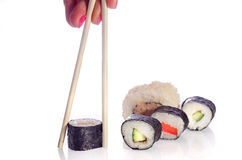 Sushi Japanese dishes. Sushi is a Japanese food consisting of cooked vinegared rice combined with other ingredients, seafood, vegetables and sometimes tropical Royalty Free Stock Photography