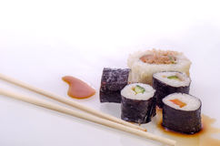 Sushi Japanese dishes. Sushi is a Japanese food consisting of cooked vinegared rice combined with other ingredients, seafood, vegetables and sometimes tropical Stock Photography