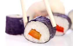 Sushi Japanese dishes. Sushi is a Japanese food consisting of cooked vinegared rice combined with other ingredients, seafood, vegetables and sometimes tropical Royalty Free Stock Photo