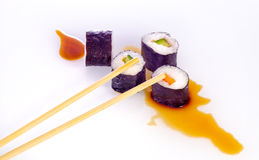 Sushi Japanese dishes. Sushi is a Japanese food consisting of cooked vinegared rice combined with other ingredients, seafood, vegetables and sometimes tropical Stock Photos